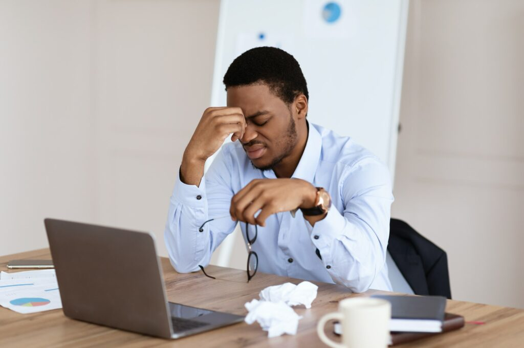 Exhausted african american manager suffering from burnout